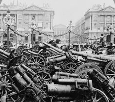 """Captured German guns during WW1 are exhibited in the Place de la Concorde, Paris, France, ca.1920. The short-barreled guns in the foreground are mortars widely deployed against trenches."""
