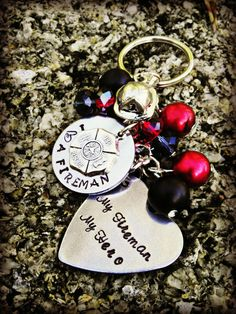 """I Love a Fireman/woman"" Key Chain (includes a fire helmet, firefighter Maltese cross, an engraved heart and red/black beads) 