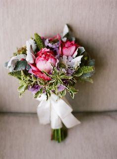 Gorgeous pink, purple and green tones in this bridal bouquet. #bridalbouquet #pinkandpurplebouquet #weddinginspiration www.gmichaelsalon.com