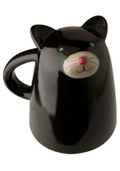 Super cute black kitty cat mug. Right way up the mug sits flat on the cat's face but turn it upside down and you have a cute cat face smiling up at you. A fun addition to any office or kitchen. Cat lovers will adore this mug!  Size: 4.8′x 3.3′x H3.7′  Material: Ceramic