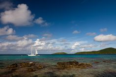 A sailboat anchored on the waters near Playa Melones in Culebra. The nearby beach is full of coral pieces from the offshore reefs. Culebra, Puerto Rico.