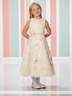 Sleeveless lace over satin tea-length A-line dress adorned with three-dimensional flowers and butterfly appliqués, jewel neckline