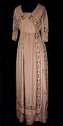 """c. 1912 Fabulous Ecru Silk Crepe Beaded Evening Dress with Lace and Beaded Tassels. This fine silk crepe evening gown exhibits the favorite features of the period - the classic Empire waistline (corded for emphasis), luscious tunic skirt; pleated and pearled """"vee"""" neckline, and two-layered sleeves! The gown is extensively adorned with pearl and bugle bead trim, on the exquisite large lace collar, sleeves and tunic, and on the tabard-type slit up the skirt's left side. Front"""