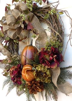 Front Door Wreaths, Silk Floral Wreaths, Artificial, Grapevine Wreaths, Silk Wreaths, Etsy Wreaths    ~ Warm Harvest Fall Wreath ~  This beautiful, fall wreath will make your house look warm and inviting all season long. I created this wreath with a gorgeous swirling burlap bow, large autumn colored flowers, berries, sparkling leaves, beautiful greenery, wispy sprigs, an orange pumpkin and gourd, all adorned on a grapevine wreath. This is the perfect wreath to display on your front door…