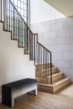 Hacin+Associates transformed a 1932 Tudor Revival into a modern family home with open interior, original details, sleek finishes & contemporary furnishings.