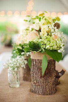 Log vases beside clear jars with small blooms #wedding #flowers #vintage #vintagewedding #weddingdecor