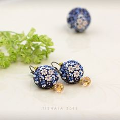 The night blushes. Handmade applique floral polymer clay Handmade polymer clay earrings made out of navy blue fimo clay and adorned with little flowers. Floral, applique, clay embroidery, etsy, SALE.