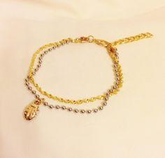 A personal favorite from my Etsy shop https://www.etsy.com/listing/179944340/ladybird-charm-multi-strand-braceletgold