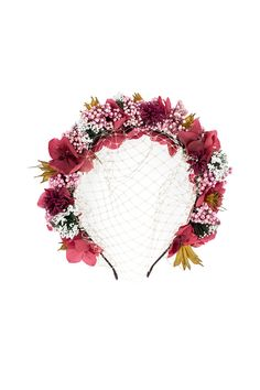 Diadema de flores con redecilla, de Rita Von.