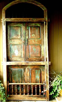Antique European Door, Strong Architectural Lines With Domed Iron Work and Double Dutch Doors. via Etsy.