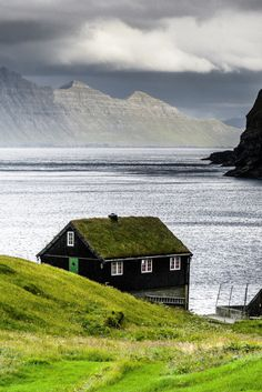"""scandinaviapictures: """"The house on the fjord, Faroe Islands (by Mike7050) """""""