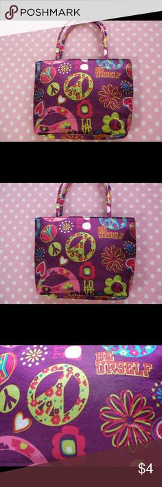 "Fun PEACE AND LOVE bag Fun PEACE AND LOVE bag   DETAILS: Fun bright colored bag with peace signs, LOVE and hearts print.  Zipper closure   Small handle  H 12"" (handle to bottom) x W 9"" x D2"" Please let me know if you have any questions…. HAPPY to receive reasonable offers and encourage bundles!! Thank you for visiting my closet! Bags Mini Bags"