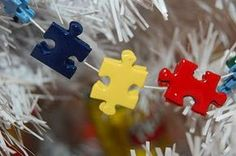 How to Make Crafts: Using Puzzle Pieces there are some here I'd like to use. Time to start collecting cheap puzzles from good will Puzzle Piece Crafts, Puzzle Art, Puzzle Pieces, Game Pieces, Christmas Tree Garland, Christmas Tree Ornaments, Christmas Decorations, Xmas Tree, Christmas Projects