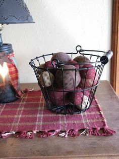 Use this adorable black wire basket at the Quilt Shop to store and display things in your home! It's perfect for complimenting the decor in any room! https://www.primitivestarquiltshop.com/collections/farmhouse-primitives/products/black-wire-basket #primitivefarmhousedecor