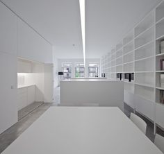 Interior of the Zurcatnas Office in Porto by Paulo Santa Cruz. I like the all-white furniture and the long line of light accentuating the depth of the interior.