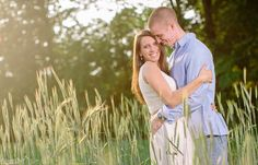 engagement session photos in a field of wheat
