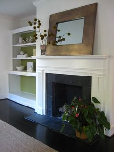 Love the clean lines of the fireplace & mantle. Built in shelves are nice. I would put doors on the bottom cupboard