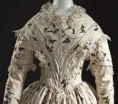 Woman's Dress England, 1845-1849 Costumes; principal attire (entire body) Silk plain weave with warp-float patterning, printed, silk lace and silk passementerie Center back length: 56 1/4 in. (142.875 cm) Purchased with funds provided by Suzanne A. Saperstein and Michael and Ellen Michelson, with additional funding from the Costume Council, the Edgerton Foundation, Gail and Gerald Oppenheimer, Maureen H. Shapiro, Grace Tsao, and Lenore and Richard Wayne (M.2007.211.744)