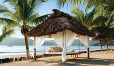 Viceroy Zihuatanejo: The white-sand beach has private palapas for couples to collapse in relaxation.