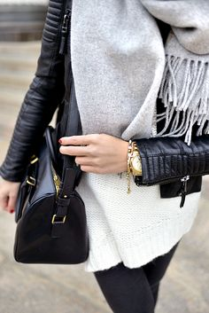 Quilted black leather jacket, chunky grey scarf, black leather bag, gold bracelets