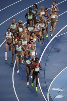 Runners compete in the Women's 10000m during the athletics event at the Rio 2016…