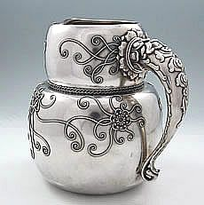 Rare and unusual Whiting sterling pitcher with unusual filigree wire application. In a style we have not encountered before, this Whiting pitcher has flowers and branches made up of applied twisted filigree wire and inset cast sterling silver balls.