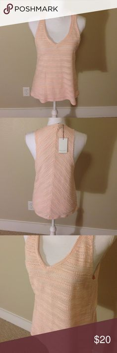 Light pink tank Light pink textured v neck tank by Bella Luxx, NWT!! Easy staple piece for any closet. Layer or wear alone, the possibilities with this comfy and form fitting tank are endless!! belle luxx Tops Tank Tops
