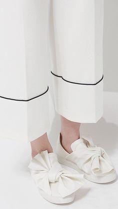 winslow oversized white bow slip on