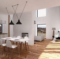 Interiér - jídelna a obývací pokoj předělený stěnou s krbem
