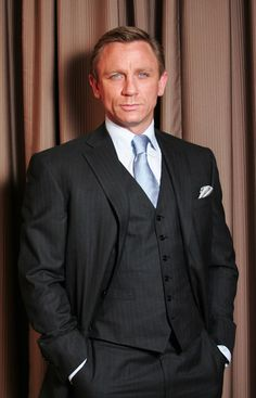 Bond, James Bond Love the light blue tie and shirt against the charcoal suit.