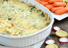 Baked Spinach Artichoke Dip is creamy, cheesy and packed with flavor. It's perfect for an easy holiday or game day appetizer!