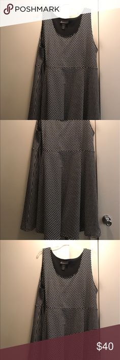 Black&white polka dot dress Black&white polka dot dress . Has some stretch. Also flares out at the bottom. Very flattering and nice with an added cardigan or blazer Lane Bryant Dresses