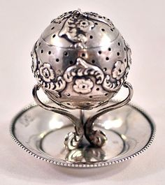 Antique Sterling Silver Tea Infuser Ball with Stand manufactured by F. M. Whiting  Company, founded in 1878,