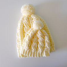 Stephanie made yet another adorable crochet pattern: Cabled Beanie Version 2. I altered it to make one for the baby too. I have one more on my hooks that looks just like the one she made with the c…