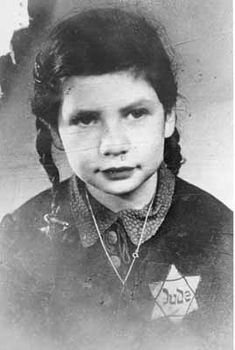Hanna Lehrer, a Munich Jew, wears both her personal Jewish star around her neck and the mandated Yellow Star badge identifying her, isolating her, and alienating her from other Germans. Hanna was later sent to Riga, Latvia, where she was killed.