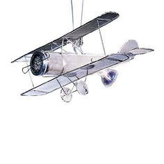 Finely handcrafted chrome biplane art fixture suspends from two six three lengths of field-cuttable and bendable wire leads. Airplane Lights, Airplane Room, Basement Lighting, Kids Lighting, Home Decor Lights, Light Decorations, Pendant Track Lighting, Light Pendant, Commercial Lighting