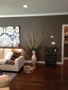 Wall color -- Sherwin WIlliams SW7040 Smokehouse for my accent wall  Dining room? Also like art on wall