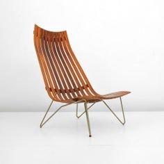 """Designer & Manufacturer: Hans Brattrud; Hove Mobler Markings: marked Country of Origin & Materials: Norway; wood, metal Additional Information & Circa: Lounge chair by Hans Brattrud. Dimensions: 41.5""""h, 29""""w, 33""""d"""