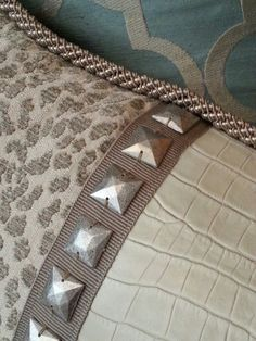Use upholstery nails with nail lock from Rowley Company I L an B Designs