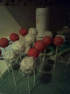 Cake pops w/ red sugar sprinkles and coconut