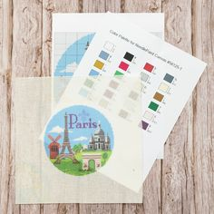 """""""#Paris is always a good idea."""" - Audrey Hepburn This Paris Christmas ornament canvas features: 🔹 The #EiffelTower 🔹 Arc de Triomphe 🔹 #Sacré-Cœur 🔹 A fleur de lis 🔹 The #MoulinRouge Your order will include the #needlepoint design printed on high-quality Zweigart mono deluxe canvas. You will also receive a printed color aid and #stitch guides for your #canvas to aid in your stitching. Needlepoint Designs, Needlepoint Kits, Needlepoint Canvases, Christmas In Paris, Audrey Hepburn, Stitching, Palette, Christmas Ornaments, Printed"""