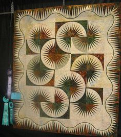 Japanese Fan ~ Quiltworx.com  Joan Boyle ~ Comox, BC, Canada  This quilt was made in 2010 and received 1st place in the Large Quilt, Viewers Choic Award, and Best of Show at the Comox Valley Exhibition!     Joan says: