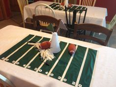 Football centerpiece, party decoration tablecloth for football party. Megaphone, whistles, poms.