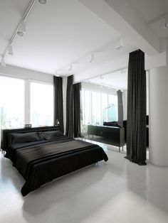 This modern black and white studio is devoid of any area rugs! I would add at least one here in the bedroom and make it a sophisticated damask by Candice Olson. Details: http://pinterest.com/pin/285556432593564786/
