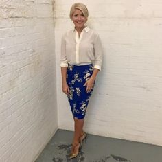 UK morning show host, Holly Willoughby. Classic shape pencil with bold graphic print and soft blouse.