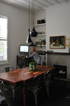 Great dining room/office area~Janette Maclean via Design Mom   Can't help it...I still love white walls best of all :)