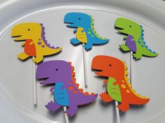 Dinosaur cupcake toppers. You will receive one dozen of these cute cupcake toppers. These are bright and any child would love these at his party! Colors can be customized! Please check out my other matching items! Please read policies for any information on use, copyright,