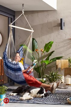 From balconies to backyards, this hammock chair, fresh greenery and a lovely group of lanterns will make you want to lounge for hours.