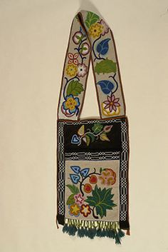 """Bandolier Bag. Ojibwe. Late 19th or early 20th century. Velvet, ribbon, glass beads, 14 """" x 19 1/2"""" (pouch) and 5""""x 44"""" (strap). Cass County Museum and Historical Society"""