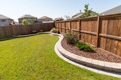 Antique Brown Retaining Wall with mow strip
